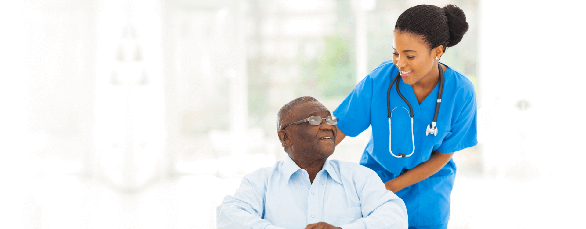 Smiling nurse and elderly man